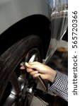 Small photo of Tire air pressure checking before travel