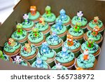 colourful funny cupcakes in box | Shutterstock . vector #565738972