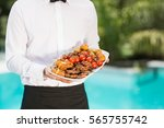midsection of waiter holding... | Shutterstock . vector #565755742