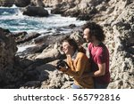 woman photographing landscape... | Shutterstock . vector #565792816