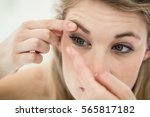 close up of young woman... | Shutterstock . vector #565817182