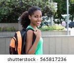 laughing latin female student... | Shutterstock . vector #565817236