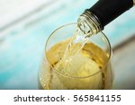 glass of white wine being... | Shutterstock . vector #565841155