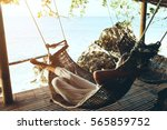 woman relaxing in the hammock... | Shutterstock . vector #565859752