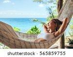 woman relaxing in the hammock... | Shutterstock . vector #565859755