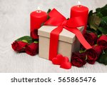 Red Roses And Gift Box On A...