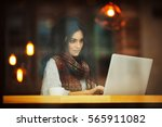woman working with laptop in... | Shutterstock . vector #565911082