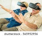 senior mature couple having fun ... | Shutterstock . vector #565952956