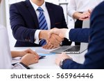 business handshake at meeting... | Shutterstock . vector #565964446
