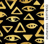 gold brush drawn eyes and... | Shutterstock . vector #565978432