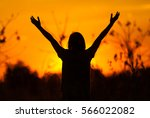 woman feeling free on sunset... | Shutterstock . vector #566022082