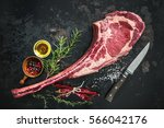 dry aged raw tomahawk beef... | Shutterstock . vector #566042176