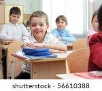 schoolchild behind desks at... | Shutterstock . vector #56610388