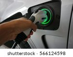 plug the charger to power to... | Shutterstock . vector #566124598