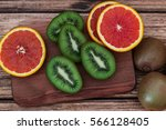 orange kiwi on the wooden... | Shutterstock . vector #566128405