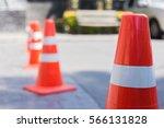 orange traffic cone on park in...   Shutterstock . vector #566131828