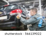 man working in the auto repair... | Shutterstock . vector #566139022