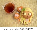 Small photo of Sandwich in the form of the head of the girl and tea. Chib. Sandwich is made of a roll and cheese. Creative food for children