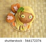 Small photo of Sandwich in the form of the girl's head. Chib. Sandwich is made of a roll and cheese. Creative food for children