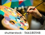 artist painting with acrylic... | Shutterstock . vector #566180548