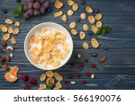 tasty cornflakes with milk on... | Shutterstock . vector #566190076