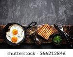 fried eggs on dark background... | Shutterstock . vector #566212846