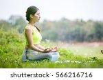 beautiful young woman wearing... | Shutterstock . vector #566216716
