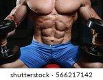 brutal muscular man with beard... | Shutterstock . vector #566217142