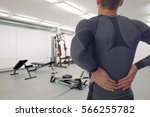 man with low back pain in gym.... | Shutterstock . vector #566255782