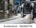 pickup truck on a flooded street | Shutterstock . vector #566383756