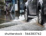 pickup truck on a flooded street | Shutterstock . vector #566383762