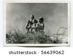 Vintage photo of happy family (fifties) - stock photo