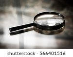 loupe close up on the surface... | Shutterstock . vector #566401516