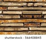 wall built of flat stones | Shutterstock . vector #566408845