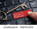 Small photo of Closed up finger on keyboard with word LOYALTY PROGRAM