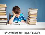 seven years old child reading a ... | Shutterstock . vector #566416696