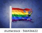 Torn Rainbow Flag Against...