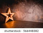large wooden star with a large... | Shutterstock . vector #566448382