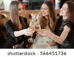 cheerful girls clinking glasses ... | Shutterstock . vector #566451736