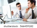 young businessmen discussing a... | Shutterstock . vector #566459182