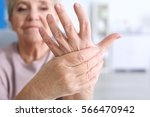 elderly woman suffering from... | Shutterstock . vector #566470942