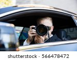 man sitting inside car... | Shutterstock . vector #566478472