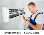male electrician checking air... | Shutterstock . vector #566478886