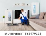young male electrician fixing... | Shutterstock . vector #566479135