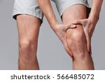 man  with knee pain on color... | Shutterstock . vector #566485072