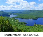 Small photo of Mont Tremblant National Park, Laurentian Mountains, Quebec (close to Montreal), Canada, America. 18 July 2015. Landscape showing the wilderness in Canada with lake, forest and blue cloudy & sunny sky