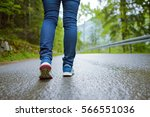 close up of woman runner legs... | Shutterstock . vector #566551036