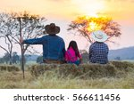 the back family farmers sunset | Shutterstock . vector #566611456