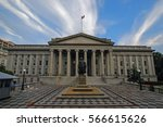 Small photo of Washington, D.C.USA - August 04, 2012: Treasury Building, Architects: Ammi Burnham Young and Statue of Albert Gallatin. fantastic blue sky with white extended clouds