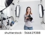 young female photographer... | Shutterstock . vector #566619388